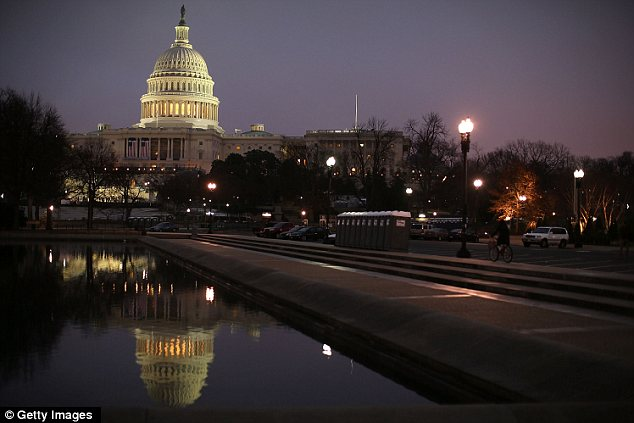 Moment of quiet: The U.S. Capitol is reflected in a pool i the early morning