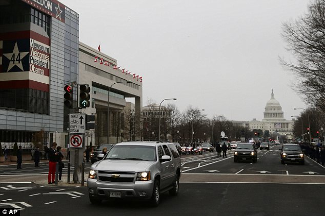Practice car: A silver sports utility vehicle representing the limousine that President Barack Obama and first lady Michelle Obama will ride in drives down Pennsylvania Avenue in Washington