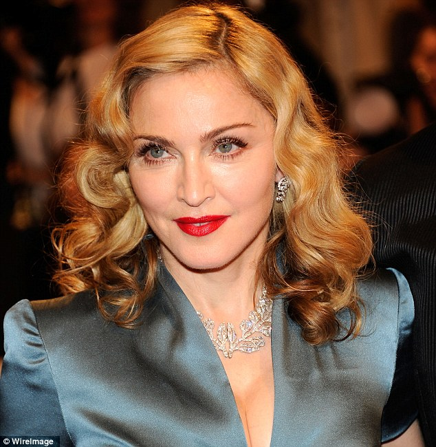 Downsizing: Madonna, seen here in New York on May 2, 2011, owns property around the world but seems to want to scale down for the moment