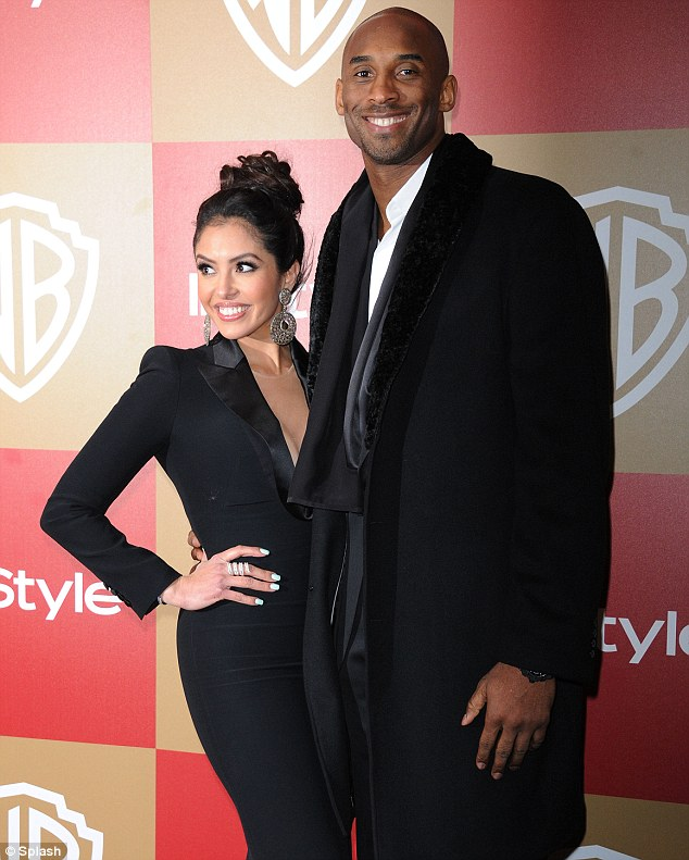 Happier than ever! Kobe Bryant poses with his wife Vanessa at the Warner Brothers Golden Globes party in Beverly Hills