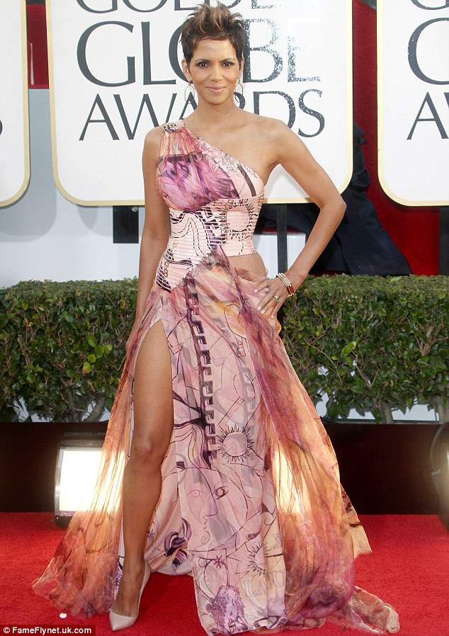 Not a good look: Halle's Versace dress showed off her wonderful figure but wasn't a winner in the style stakes