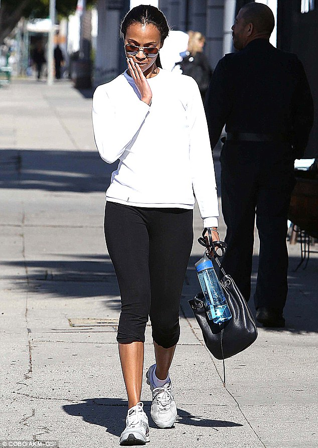 Don't be sad: Zoe Saldana steps out in West Hollywood, California, and heads to the gym