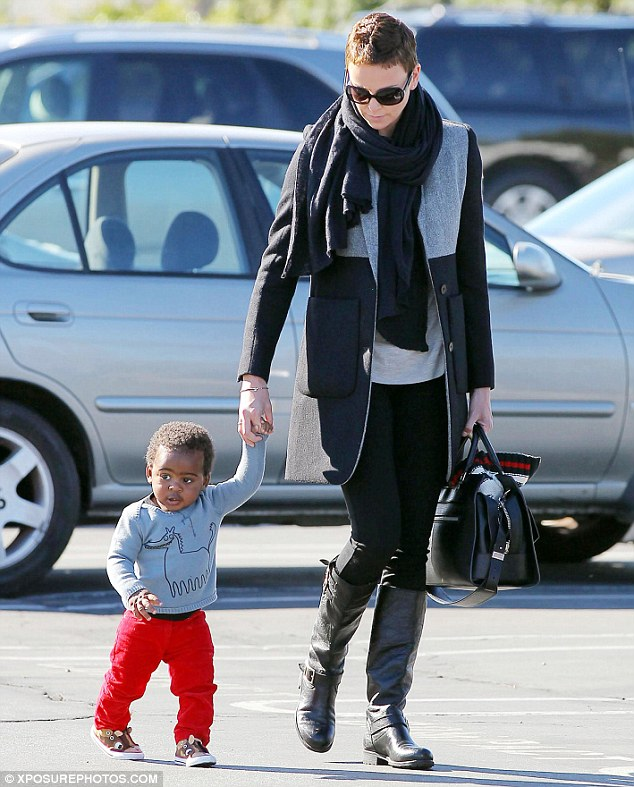 Look at him go! Charlize Theron's son Jackson is seen walking for the first time as the actress takes a break from holding him