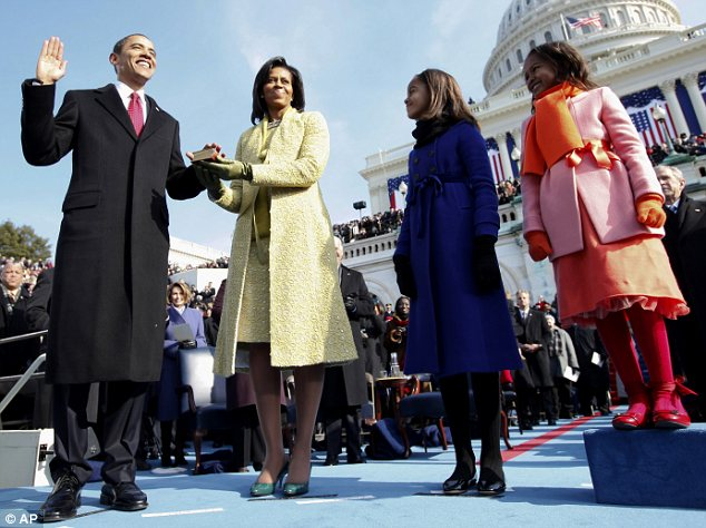 This Jan. 20, 2009 file photo shows Barack Obama, left, taking the oath of office from Chief Justice John Roberts, not seen, as his wife Michelle