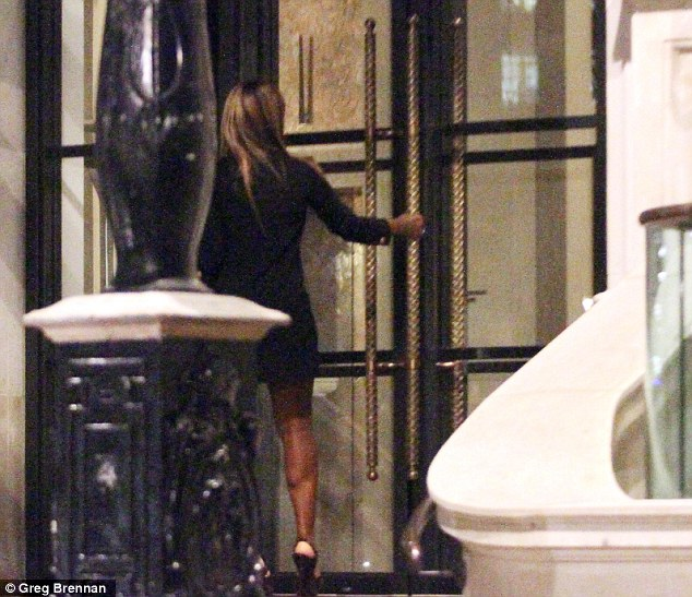 Ready for a sleepover? Alexandra made her way into the hotel after partying with Piven at club Lou Lou's