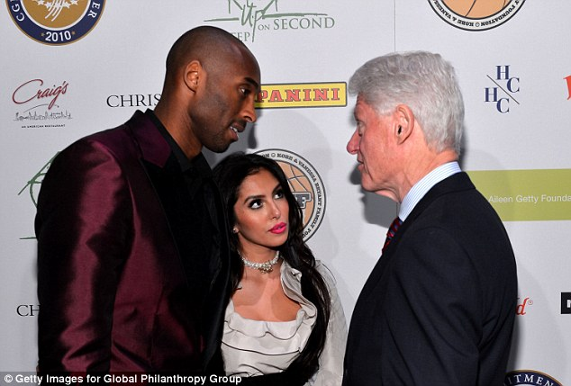 Listen up: The couple had a talk on the red carpet with President Clinton