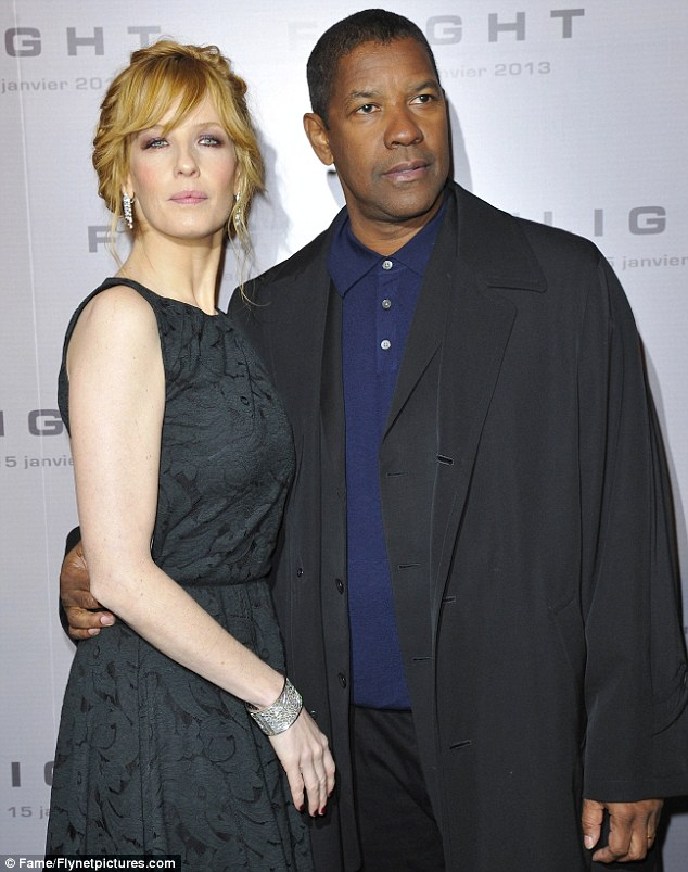 Time to shine: Denzel Washington and Kelly Reilly attend the Paris premiere of Flight on Tuesday night