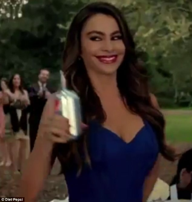 How low can you go: Sofia showcases her curves in the low-cut frock in the advert, which aired during the Golden Globes Awards on Sunday