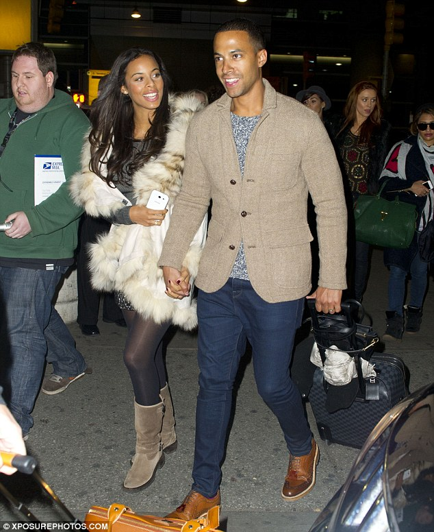 Protective husband: Marvin Humes hold on tightly to pregnant wife Rochelle Wiseman as The Saturdays jet to New York