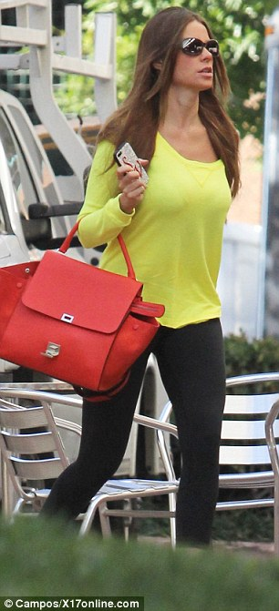 Check me out: The actress wore tight black leggings, teamed with pink trainers and a florescent yellow top
