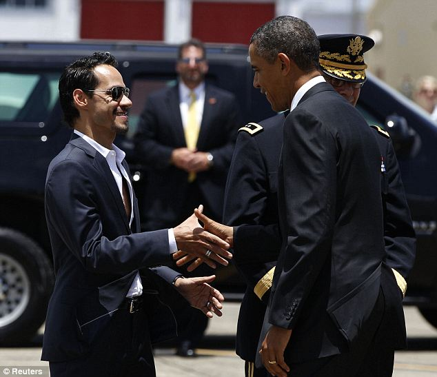 Pals: Marc Anthony, seen here with the President in Puerto Rico in 2011, will sing his song Mi Gente