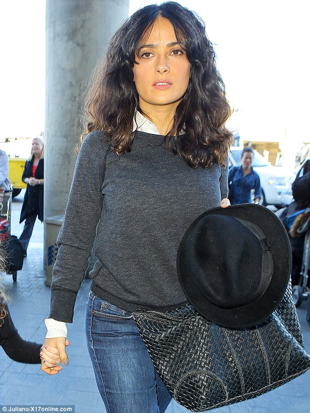 Dressed down: Salma dressed casually in a grey jumper and white shirt teamed with some jeans