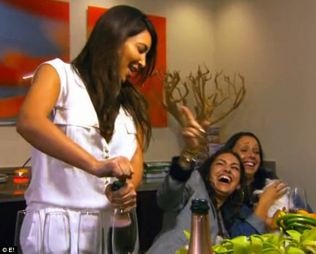 Special occasion: Kim popped open the champagne to make the most of Khloe's visit