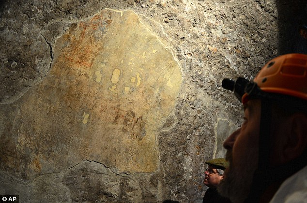 Brightly coloured fragments of frescoes were found during a restoration of a passageway inside the Colosseum