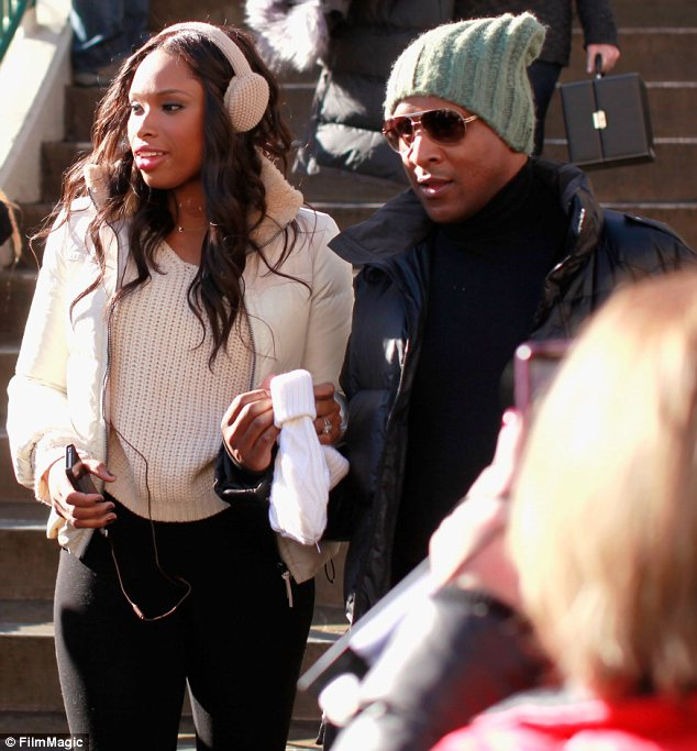 Cold snap: Jennifer Hudson was wrapped up warn as she and fiance David Otunga arrived at Sundance Film Festival in Park City, Utah on Friday