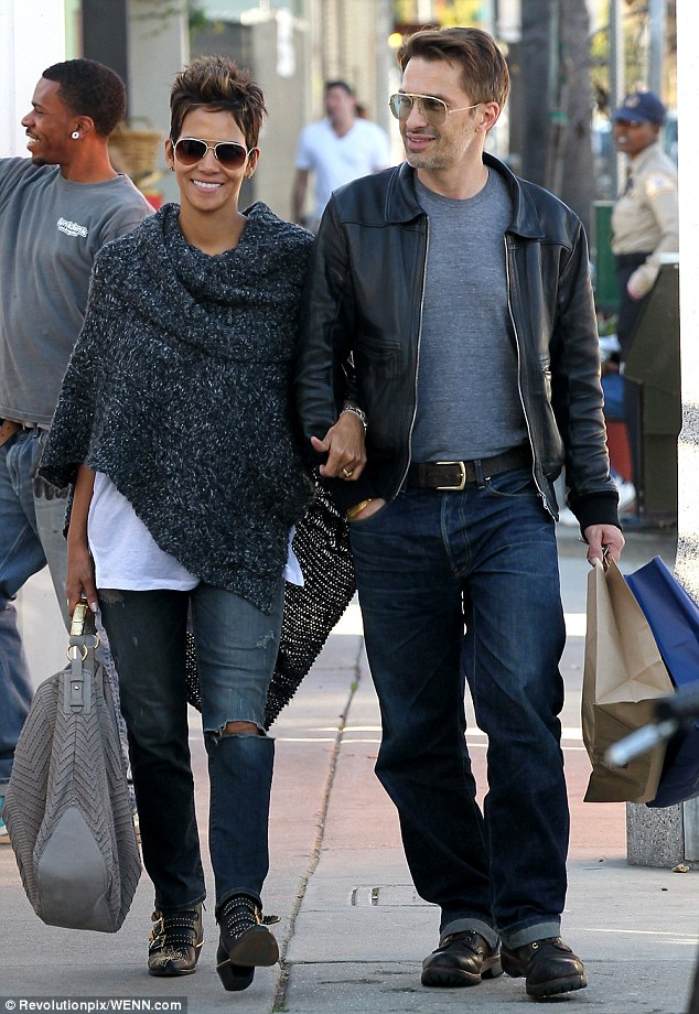 Scoring some new clothes: Halle Berry and boyfriend Olivier Martinez strolled arm in arm as they shopped in Venice Beach, California on Friday