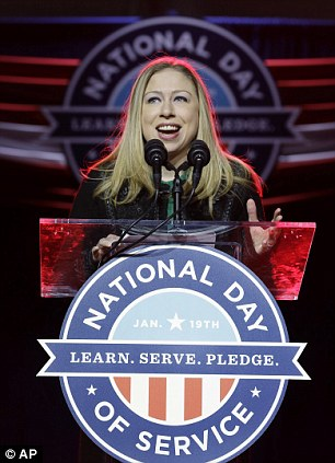 Celebrity friends: Chelsea Clinton, left, gets a hand from Eva Longario, right, at the summit in Washington