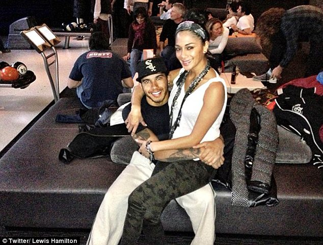 She's bowled over! Nicole Scherzinger and Lewis Hamilton were seen cuddling up together at a bowling alley
