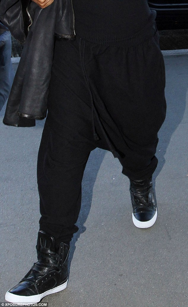 Baggy: The crotch of Janet's trousers nearly reached down to her sneakers