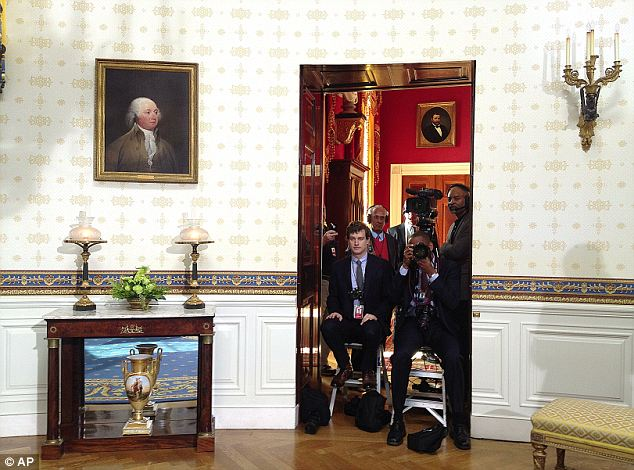 Watching: The cameramen from the White House Press Pool watched and recorded the oath