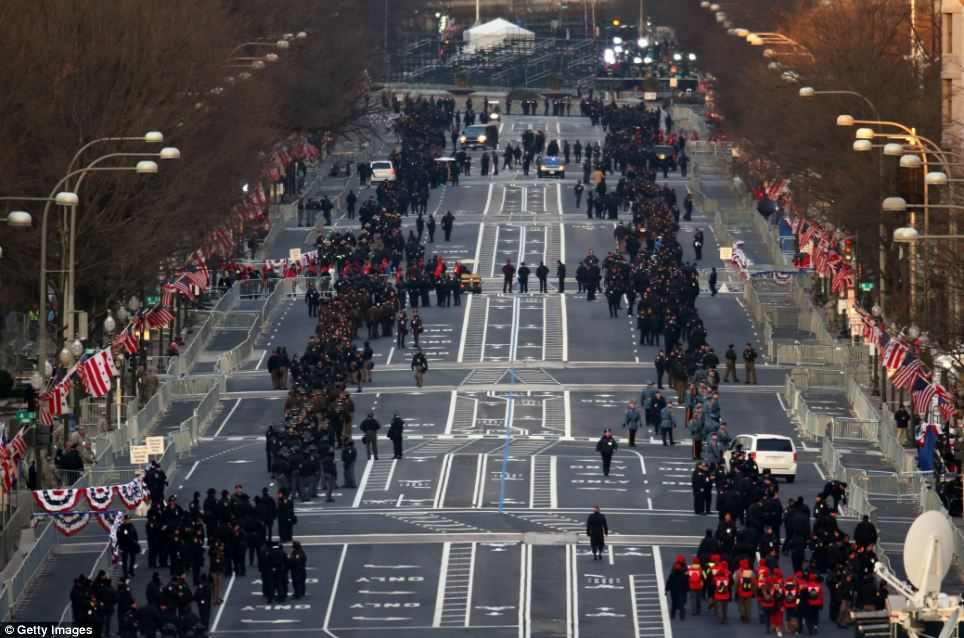 Gearing up: People begin to gather along Pennsylvania Ave. before the inauguration at the U.S. Capitol