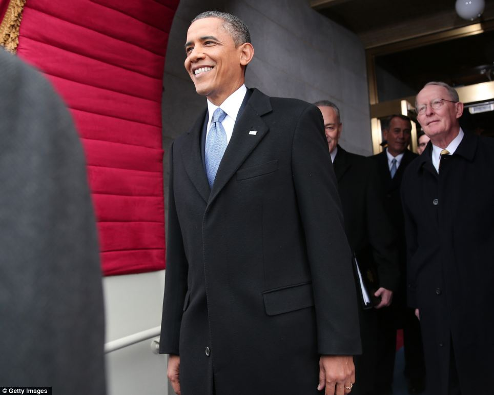 All smiles: President Barack Obama grins as he arrives to cheers during the presidential inauguration on the West Front of the U.S. Capitol in Washington, DC