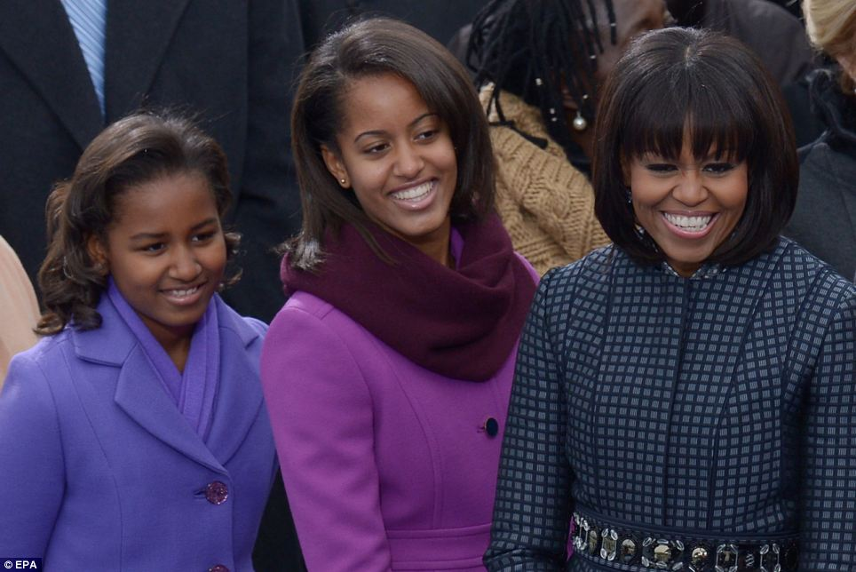 Proud: The girls burst into giggles as the crowd cheered when their names were announced. They joined their mother Michelle on stage