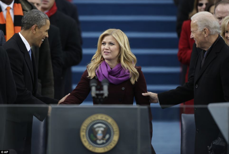 Starstruck: Kelly Clarkson is greeted by President Obama and Vice President Joe Biden following her performance