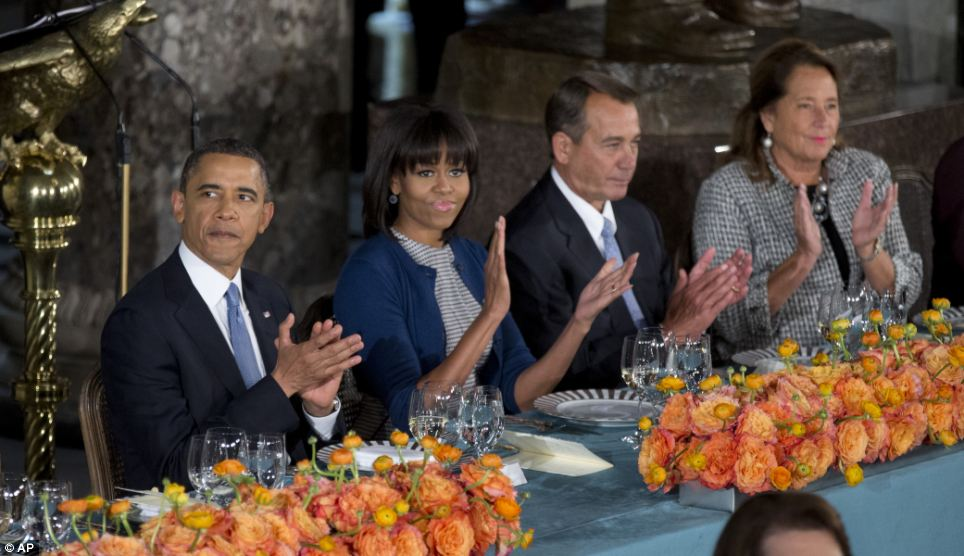 Together: President Obama and Michelle sit beside Speaker of the House John Boehner and his wife Deborah Gunlack at the luncheon