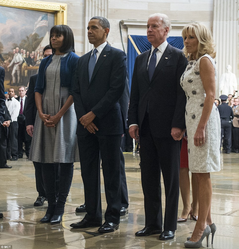 Paying their respects: First Lady Michelle Obama, President Obama, Vice President Joe Biden and Dr Jill Biden pause to pay their respects at the Martin Luther King, Jr. statue in the Capitol rotunda as they leave the Inaugural Luncheon