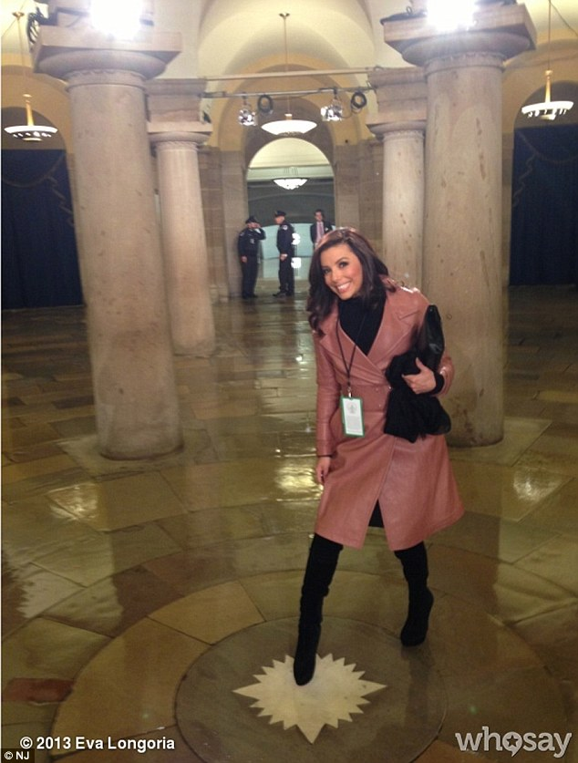 IEva tweeted: 'Touching the center of the city here in the Capitol for good luck!'