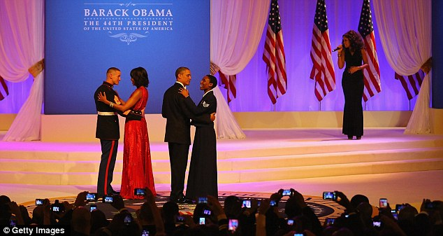 Honored: Barack and Michelle danced with service members during the ball to celebrate his second term