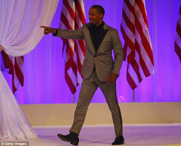 Grand entrance: Foxx made a grand entrance to the stage in his snappy grey tuxedo