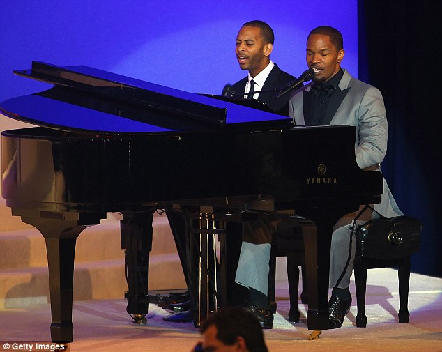 All-round performer: Jamie Foxx took to the piano during the Commander-In-Chief's Inaugural Ball