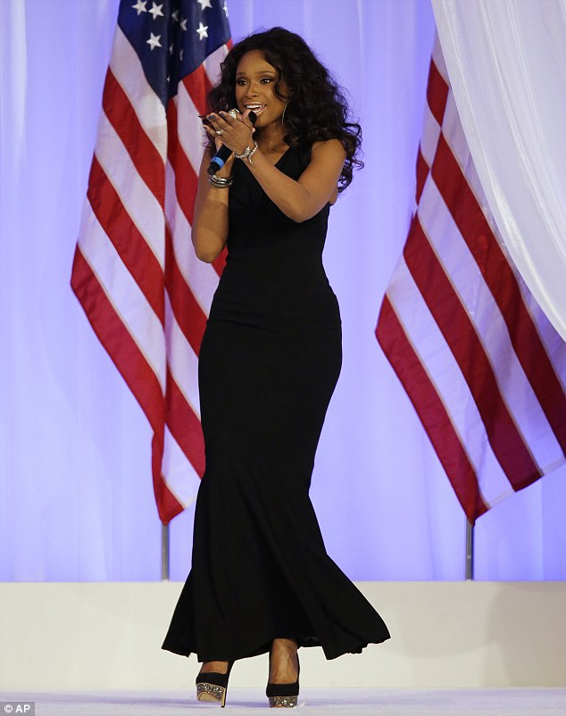 Slinky: The stunning star looked sensational in a slinky cowl neck black gown and sparkly platform high heels for her performance