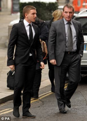Hearing: The court heard the woman could remember waking up in a hotel room the next day in a double bed next to Anton Rodgers, pictured here arriving at court with his father Brendan Rodgers