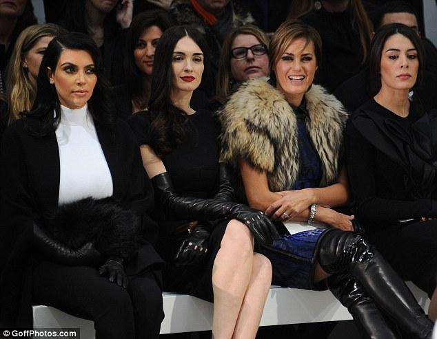 It's fashion, baby! Kim sist alongside Sofia Essaidi and Yasmin Le Bon
