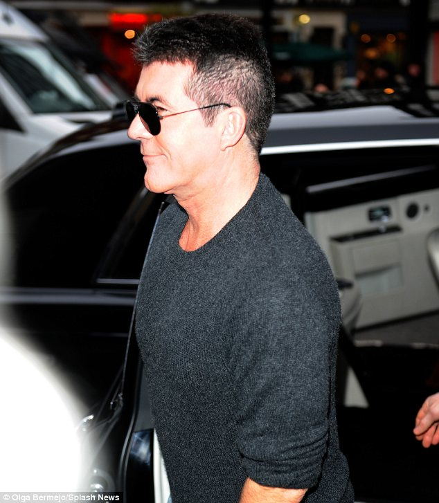 Making a confident arrival: Simon arrived smirking following his altercation with Amanda on Sunday
