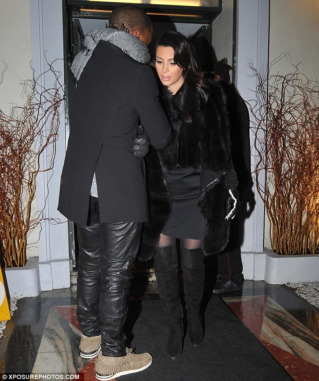 Date night: Kanye made sure to coordinate his ensemble with his girlfriend's outfit as they enjoyed an evening at Lasserre restaurant in Paris