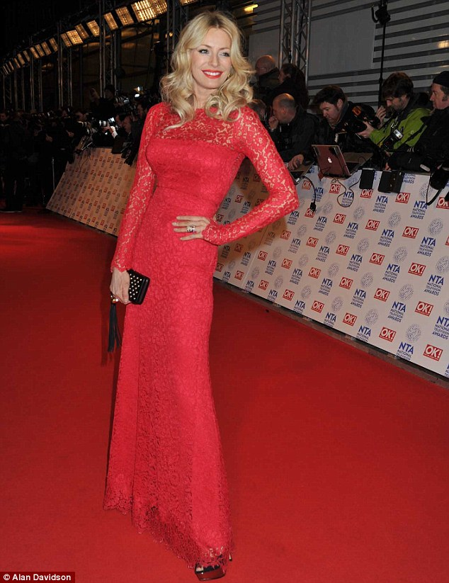 Red alert: Presenter Tess Daly also opted for a long, red gown, matching with her bright red lips