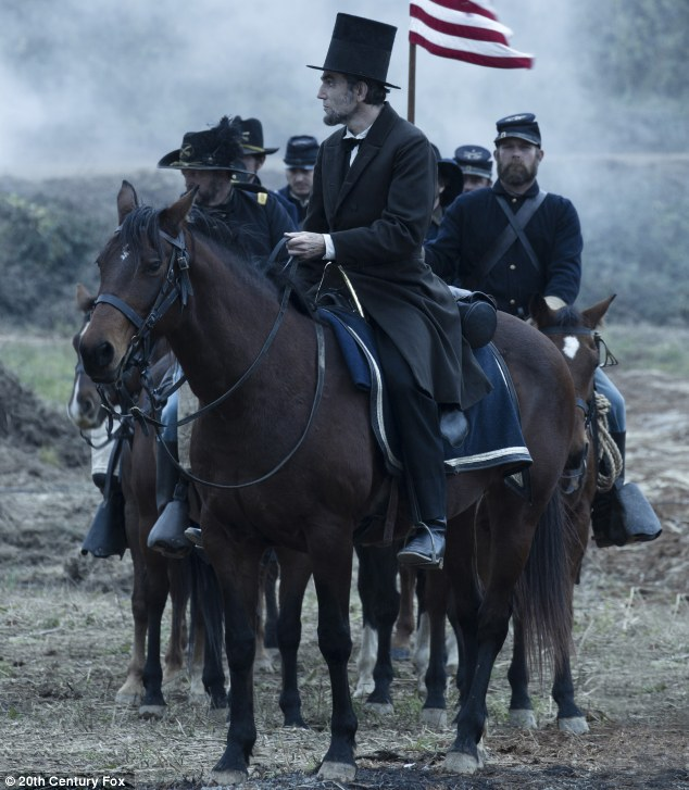 On his high horse: Daniel Day-Lewis as President Abraham Lincoln looking across a battlefield in the aftermath of a terrible siege in Lincoln