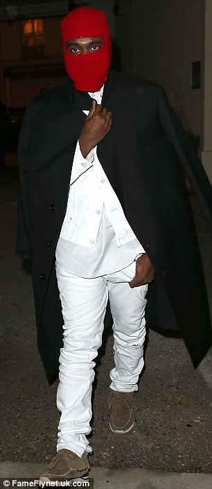 Kanye West arriving at the Martin Margiela fashion show in Paris