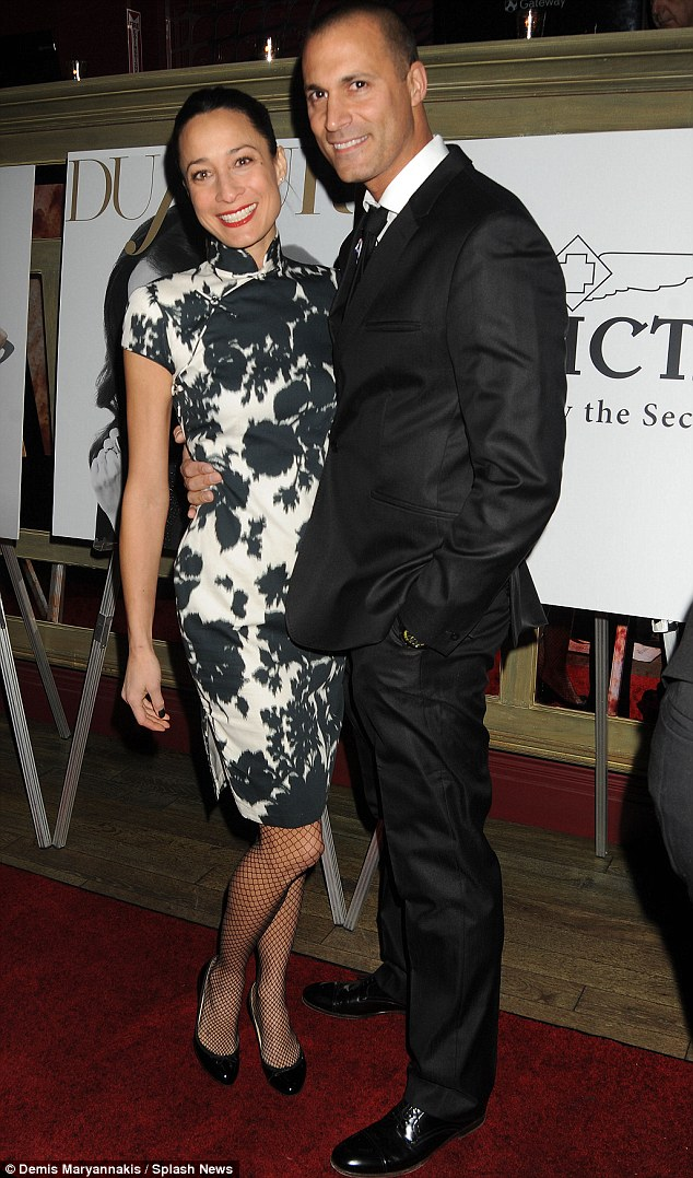 Happy couple: The pair could not stop smiling as they enjoyed the atmosphere at the DuJour February issue launch