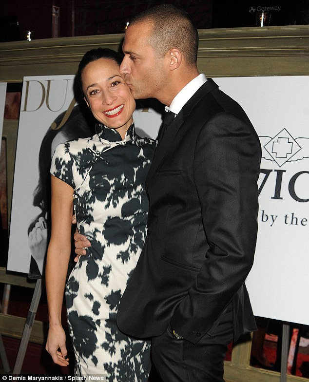 Old fashioned: Sacked America's Next Top Model judge Nigel Barker smooched his wife Cristen in New York on Wednesday