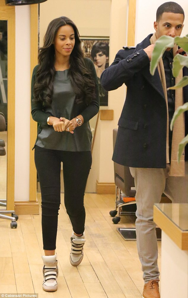 Beautiful bouncy hair: The 23-year-old looked lovely as she prepared to leave the hairdresser, showing off styled and shiny tresses