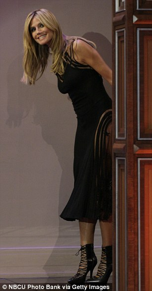 Sexy LBD: The mother-of-four's toned thighs were clearly visible to the viewers thanks to the gown's see-through panels