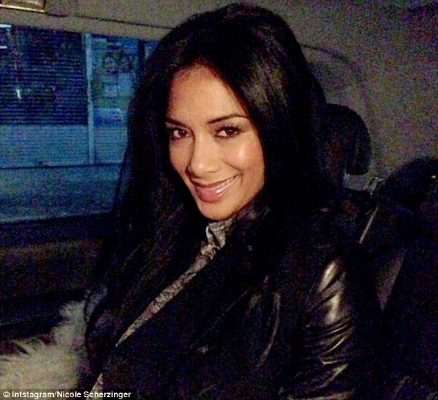 Bright-eyed: Nicole didn't seem to be suffering from a post NTAs hangover as she headed out early on Thursday morning