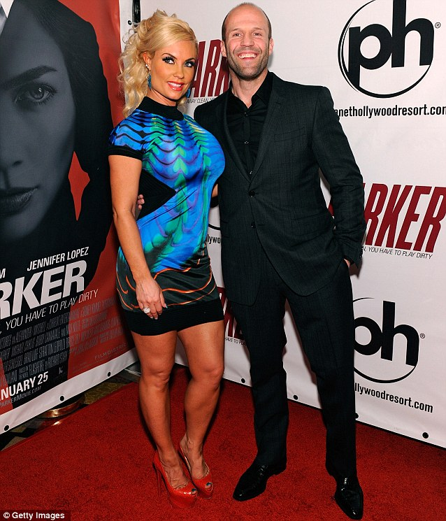 Time for Coco: Parker star Jason Statham happily posed with the bubbly blonde outside the Vegas hotel