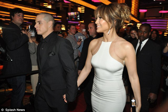 Toy boy show: Casper Smart arrived in support of his stunning girlfriend