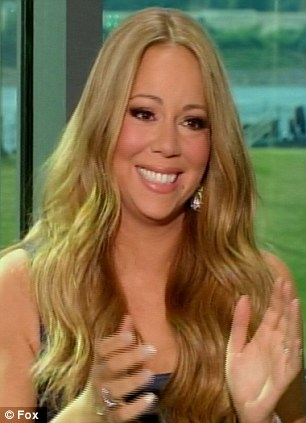 Moved: Mariah Carey was brought to tears by the performance, and Burnell's story